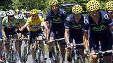 Christopher Froome, in yellow jersey, cycles in the ninth stage of the Tour de France. (JEAN-PAUL PELISSIER/REUTERS)