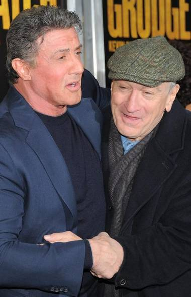 Old movie actors never really die, they just keep … cashing paycheques. Case in point: Ex-movie palooka Sylvester Stallone (67) and once-respectable thespian Robert De Niro (70) go into a clinch while promoting their new movie 'Grudge Match' in New York. Yo, Adrian! You talkin' to me? (Evan Agostini/AP)
