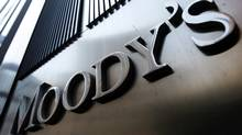 A Moody's sign on the 7 World Trade Center tower is photographed in New York in this August 2, 2011, file photo. Ratings agency Moody's is set to announce downgrades of many of the world's biggest banks, banking industry sources said, June 21, 2012 (Mike Segar/REUTERS)