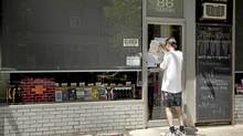 A bailiff's notice was posted on the door of the Toronto independent bookstore This Ain't the Rosedale Library and the shop was closed on Saturday. (Ryan Enn Hughes/Ryan Enn Hughes for The Globe and Mail)
