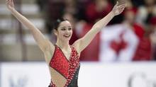 Canada's Kaetlyn Osmond salutes the crowd following her free program in the women's competition at Skate Canada International Saturday, October 27, 2012 in Windsor, Ont. Osmond won gold in the event. (Paul Chiasson/THE CANADIAN PRESS)