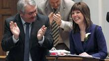 Newfoundland and Labrador Finance Minister Charlene Johnson is applauded as she reads the 2014 budget in the House of Assembly in St.John's on March 27, 2014. (GRAHAM KENNEDY/THE CANADIAN PRESS)
