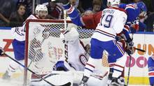 Montreal Canadiens' Andrei Markov watches as New York Rangers' Rick Nash trips over goalie Carey Price during Game 4 of the teams' first-round playoff series in New York on Tuesday, April 18, 2017. (Frank Franklin II/AP)