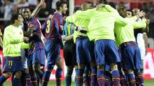 Barcelona's players celebrate at the end of their Spanish league football match against Sevilla at Ramon Sanchez Pizjuan stadium in Sevilla on May 8, 2010. Barcelona won 3-2. (JAVIER SORIANO/AFP/Getty Images)