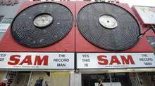 To the lament of many, the city plans to allow Ryerson University to install the iconic neon records somewhere else. (Tibor Kolley/The Globe and Mail)