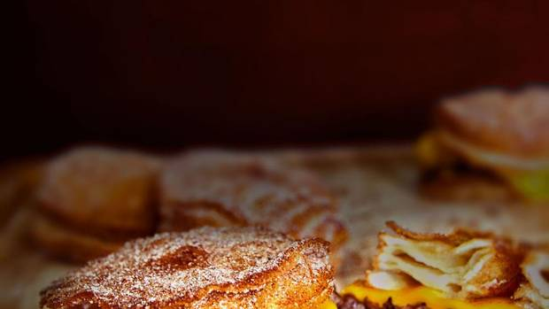 "Toronto's EPIC Burgers and Waffles made headlines worldwide with its ""cronut burger"" – a concoction offered at the Canadian National Exhibition that topped a cronut with a beef patty. Then, disaster: more than 200 people reported food-borne illness that was traced back to the cronut burger's maple bacon jam. The dish is now off the menu. But other unlikely fast-food combinations are everywhere. (LE DOLCI)"