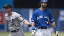 Toronto Blue Jays' Darin Mastroianni, right, is tagged out by Chicago White Sox's Gordon Beckham after making a base running error and getting caught in a rundown during the first inning of MLB action in Toronto on Sunday, June 29, 2014. (Darren Calabrese/THE CANADIAN PRESS)
