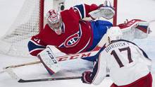 Montreal Canadiens goaltender Carey Price makes a save against Columbus Blue Jackets' Brandon Dubinsky during second period NHL hockey action in Montreal, Thursday, March 20, 2014. (Graham Hughes/THE CANADIAN PRESS)