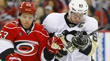 Pittsburgh Penguins center Sidney Crosby (87) and the Carolina Hurricanes center Jeff Skinner (53) battle for a loose puck during the 1st period at the RBC center. James Guillory-US PRESSWIRE (James Guillory/US PRESSWIRE)