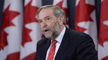 NDP Leader Tom Mulcair said Prime Minister Justin Trudeau speaks of equity gaps in the country's current marijuana laws but makes no commitment to fix them. (THE CANADIAN PRESS/Adrian Wyld)