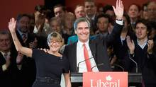 Liberal Leader Michael Ignatieff, right, and his wife Zsuzsanna Zsohar wave to supporters at the end of a Liberal Party of Canada (Quebec) bi-annual meeting on Oct. 4, 2009 in Quebec City. (Jacques Boissinot)