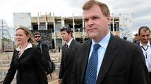Foreign Affairs Minister John Baird and Canadian ambassador to Libya Sandra McCardell, left, visit the former fortified compound of Moammar Gadhafi in Bab al-Azizya in Tripoli, Libya on Oct. 11, 2011. (Sean Kilpatrick/Sean Kilpatrick/The Canadian Press)