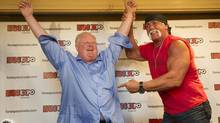 Toronto mayor Rob Ford celebrates his victory after he and professional wrestler Hulk Hogan took part in a friendly arm-wrestling match in Toronto, Ontario Friday, August 23, 2013. (Kevin Van Paassen/The Globe and Mail)