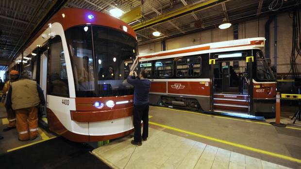 The TTC's new articulated 251 passenger low floor streetcar (LEFT) made by Bombardier. The cars will begin service in 2014. (Fred Lum/The Globe and Mail)