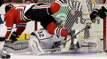 Chicago Blackhawks' Jonathan Toews (19)  flies over Los Angeles Kings goalie Jonathan Quick (32) during the second period in Game 1 of the Western Conference finals in the NHL hockey Stanley Cup playoffs in Chicago on Sunday, May 18, 2014. (Associated Press)