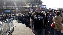 Fans line up outside Candlestick Park before a Paul McCartney concert Aug. 14 in San Francisco. (Marcio Jose Sanchez/AP)