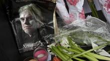 A makeshift memorial in front of Philip Seymour Hoffman's apartment building in New York on Feb. 3, a day after his death of an apparent drug overdose. (CARLO ALLEGRI/REUTERS)