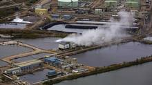 Water ponds at the Suncor tar sands operations near Fort McMurray, Alberta, September 17, 2014. In 1967 Suncor helped pioneer the commercial development of Canada's oil sands, one of the largest petroleum resource basins in the world. (TODD KOROL/REUTERS)