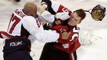 Washington Capitals' Donald Brashear (L) and Ottawa Senators' Chris Neil fight during the second period of their NHL regular season hockey game in Ottawa December 29, 2007. (CHRISTOPHER PIKE/REUTERS)