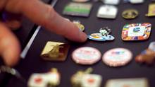 File Photo: Official 2010 Olympic pins on display (TROY FLEECE/Troy Fleece/The Canadian Press)