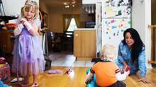 Caregiver Sandra Segura, right, who has two children back home in Mexico, takes care of Zidra Fobel, 4, left, and James Fobel, 2, centre, in Toronto on October 9, 2014. Canadian nannies are demanding that proposed changes to caregiver immigration include permanent residency on arrival. (Michelle Siu/The Globe and Mail)