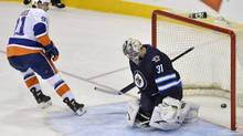 New York Islanders' John Tavares (L) scores the winning goal in the shoot-out on Winnipeg Jets goaltender Ondrej Pavelec during their NHL game in Winnipeg April 20, 2013. (FRED GREENSLADE/REUTERS)