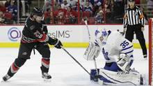 Carolina Hurricanes' Lee Stempniak is blocked by Toronto Maple Leafs goalie Curtis McElhinney on Feb. 19, 2017. (Gerry Broome/AP)