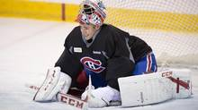 Montreal Canadiens goaltender Carey Price stretches during their training camp Wednesday, January 16, 2013 in Brossard, Que. (Paul Chiasson/THE CANADIAN PRESS)