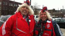 Toronto FC fans Wayne Poetschke (left) and Jeff Walter head to BMO Field for the home opener Sat. March 22, 2014. (Allie Coulman/THE GLOBE AND MAIL)