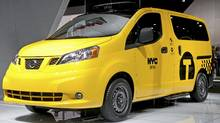 The Nissan NV200 taxi van is seen during the 2012 New York International Auto Show at the Javits Center in New York, April 4, 2012. (ANDREW BURTON/Andrew Burton/Reuters)