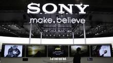 A visitor walks past Sony's booth at the Camera and Photo Imaging Show 2013 in Yokohama, south of Tokyo January 31, 2013. (YUYA SHINO/REUTERS)