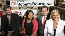 Andree Simard, wife of former Quebec Premier Robert Bourassa, his son Francois and daughter Michelle gather around Montreal mayor Denis Coderre during a ceremony renaming Montreal's University Street to Robert-Bourassa Boulevard Wednesday, August 27, 2014 in Montreal. (Paul Chiasson/THE CANADIAN PRESS)