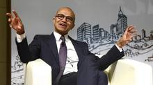 Microsoft chief executive Satya Nadella gestures as he speaks during a forum at Tsinghua University in Beijing Sept. 25, 2014. (CHINA DAILY/REUTERS)