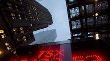 A TSX tote board is pictured in Toronto in this file photo. (Frank Gunn/The Canadian Press)