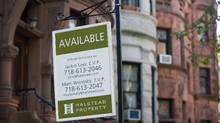 A for-sale sign hangs in front of a property in the Park Slope neighborhood of the Brooklyn borough of New York, U.S. (Craig Warga/Bloomberg)