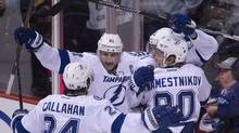 Tampa Bay Lightning center Valtteri Filppula (51) celebrates his goal past the Vancouver Canucks with his teammates during third period NHL action Vancouver, B.C. Saturday, Jan. 9, 2016. (JONATHAN HAYWARD/THE CANADIAN PRESS)