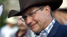Alberta Premier Ed Stelmach attends his annual Stampede breakfast in Calgary on July 12, 2010. (Jeff McIntosh/THE CANADIAN PRESS)