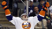 New York Islanders John Tavares celebrates his overtime winning goal with against the Toronto Maple Leafs during their NHL hockey game in Toronto, October 18, 2010. (c)