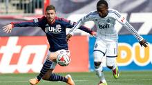 Vancouver Whitecaps forward Darren Mattocks (11) battles for the ball with New England Revolution defenseman Chris Tierney (8) during the first half at Gillette Stadium. (USA TODAY Sports)