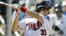 Minnesota Twins' Justin Morneau bats during the fifth inning of a spring training baseball game against the Tampa Bay Rays, Saturday, March 3, 2012, in Fort Myers, Fla. (Associated Press)