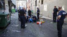 First responders attend a medical call in Vancouver's Downtown Eastside in September, 2016. (Rafal Gerszak/The Globe and Mail)