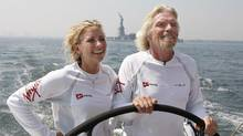 Virgin Group founder and chairman Richard Branson and his daughter Holly sail on the boat Virgin Money in New York harbour near the Statue of Liberty in 2008. (CHIP EAST/REUTERS)