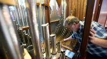 'Pipes are human,' says Grant Smalley, shown tuning a custom-built organ at Christ Church Cathedral in Victoria. (Geoff Howe for The Globe and Mail/Geoff Howe for The Globe and Mail)