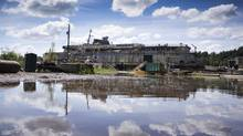 The derelict ferry, Queen of Sidney, sits along the shores of Fraser River in Mission, B.C., June 27, 2012. (John Lehmann/The Globe and Mail)