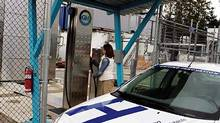 A customer fills up at one of the three hydrogen refuelling stations ina Vancouver