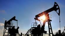 Two oil pumps silhouette. (Mikhail Kokhanchikov/Mikhail Kokhanchikov/iStockPhoto)