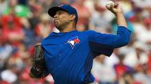 Toronto Blue Jays starter Ricky Romero pitches against the Philadelphia Phillies, March 31, 2012. (Steve Nesius/Reuters/Steve Nesius/Reuters)