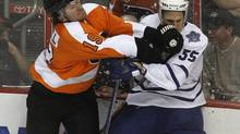 Philadelphia Flyers winger Scott Hartnell (19) checks Toronto Maple Leafs defenseman Korbinian Holzer (55) during the first period of their NHL preseason hockey game in Philadelphia, Pennsylvania, September 21, 2011. The Flyers announced on Monday they have signed Hartnell to a six-year contract extension. (TIM SHAFFER/REUTERS)