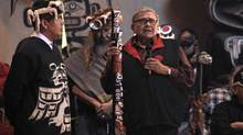 Ryan Nicolson, left, of the Musgamakw Dzawada'enuxw First Nation, is seen with his great-uncle, Robert Joseph, right, in a potlatch in March in Alert Bay. Dr. Joseph was presented with a talking stick to recognize his work with Reconciliation Canada. (Ryan Dawson)
