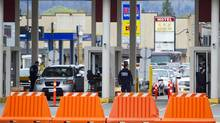 CBSA border guards inspect vehicles at the Sumas border crossing in Abbotsford, British Columbia on April 2, 2013. (Ben Nelms For The Globe and Mail)